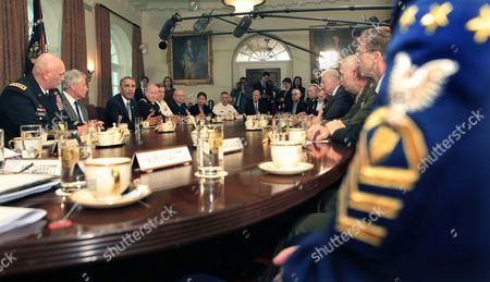 General Ray Odierno, Secretary of Defense Chuck Hagel, Barack Obama, Chairman General Martin Dempsey, Vice Chief of Naval Operations Admiral Mark Ferguson