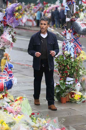 Stock Picture of Matthew Amroliwala, presenter of Crimewatch, filming close to the scene where Lee Rigby was murdered.