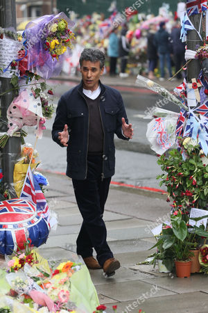 Editorial photo of Matthew Amroliwala filming for Crimewatch at the scene where Lee Rigby was murdered, Woolwich, London, Britain - 28 May 2013