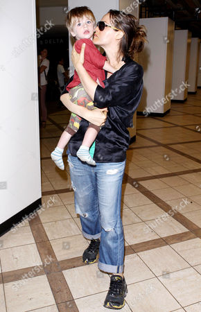 Editorial image of Alicia Silverstone and son Bear Blu Jarecki arriving at the LAX, Los Angeles, America - 03 Jun 2013