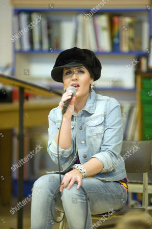 Stock Photo of Moniqe Foxx during her gig to pupils at Holy Rood Primary School in Swindon.