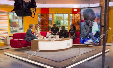 Stock Image of Aled Jones and Kate Garraway with David Harewood, Frank Kapeta and Mwajuma.