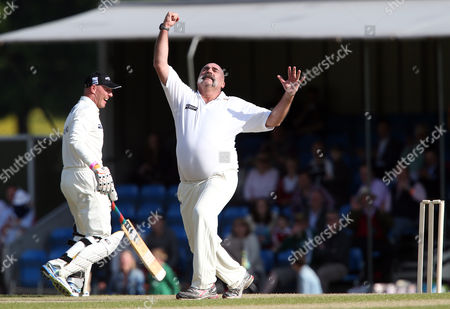 Mervyn Hughes celebrates trapping Mark Nicholas LBW and completing his hat trick