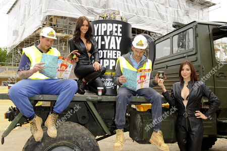 Stock Picture of Rosie Jones and Kacey Barnfield deliver tea to workmen around London