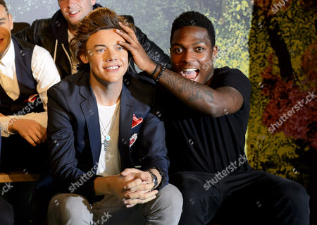 Stock Picture of Derry Mensah from The Risk with wax figure of Harry Styles from One Direction