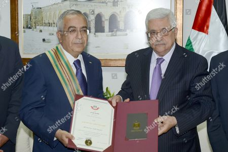 Former Prime Minister Salam Fayyad and Palestinian President Mahmoud Abbas