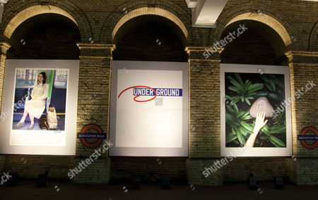 Stock Picture of New art on London Underground for it's 150th anniversary at Gloucester Road station - Posters by Gillian Wearing, Lawrence Weiner and Haegue Yang