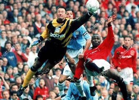 Editorial photo of EIKE IMMEL MANCHESTER CITY GOALKEEPER MAKING SAVE, BRITAIN - 1995