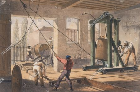 Rolls of cable at Gutta-percha (rubber) Works From WH Russell The Atlantic Telegraph London 1866. Tinted lithograph