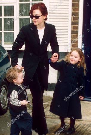 MARINA OGILVY LEAVING HOUSE WITH CHILDREN ZENOUSKA AND CHRISTIAN