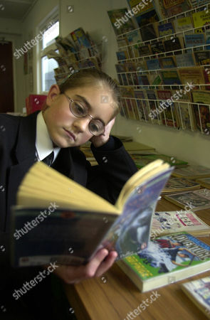 Speke Community Comprehensive School In Liverpool. Reading Clubs In School Feature. In A World Of Her Own That Only A Good Book And Your Own Imagination Can Conjure Up. Lisa Thomas 12-year-old Pupil At The School.