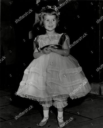 Stock Image of Bridesmaid Miss Gavia Wilkinson-cox At The Wedding Of Miss Marian Manningham-buller And Edmund Brudenell At St Margarets.