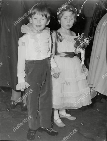 Editorial photo of Wedding Of Marian Manningham-buller And Edmund Brudenell At St Margaret's Showing Pageboy 5yo Lord Hesketh With Bridesmaid.