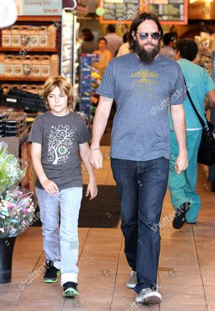 Editorial image of Chris Robinson and Ryder Russell Robinson at Whole Foods in Brentwood, Los Angeles, America - 13 Jun 2013