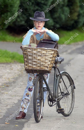 Lady Henrietta Bathurst With Her Victorian Bike........ Lady Henrietta Bathurst Fashion Designer Daughter Of Earl Bathurst With A Bicycle She Found On Her Parents' Cirencester Park Estate. Picture Kevin Holt For Nigel Dempster Diary.
