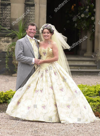 Actress Jacqueline Pirie (linda Sykes) And Actor Johnny Briggs (mike Baldwin) Filming Wedding Scenes For Tv Programme Coronation Street At Arley Hall In Cheshire.