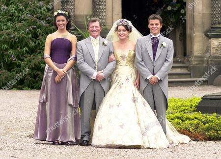 Actress Jacqueline Pirie (linda Sykes) And Actor Johnny Briggs (mike Baldwin) Filming Wedding Scenes For Tv Programme Coronation Street At Arley Hall In Cheshire. Paul Fox (r) Plays Linda's New Son-in-law Mark Baldwin.