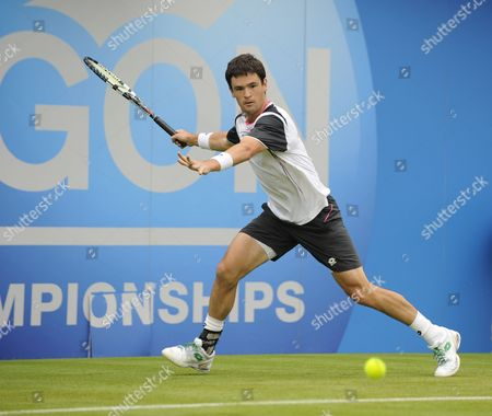 James Baker In Action. James Baker Beats Oliver Golding 12th June .2012. London Queens Club Tennis Champs