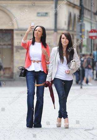 Kaya Hall (left) Girlfriend Of Phil Jones Takes A Walk In The Centre Of Krakow Poland. - 13.06.12.