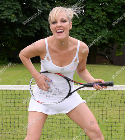 Bowie Jane playing the air guitar with a tennis racquet
