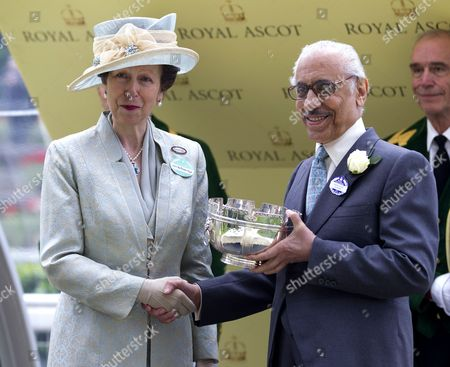 Stock Image of Princess Anne presents Prince Khalid Abdullah with the trophy after winning the Ribbledales Stakes.