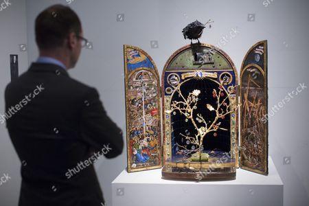 Stock Photo of Jim Kay looking at his artwork