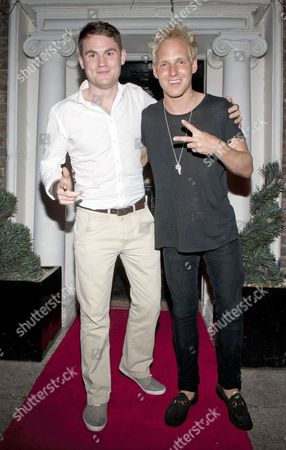 Stock Photo of Michael Carney, MD Raindrop drinks and Jamie Laing