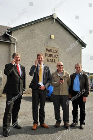 Stock Image of Shetland MP Alastair Carmichael, John Mccracken, Vodafone's Regional Network Manager for Scotland with Walls' Local Community Champions Doug Forrest and Ian Walterson