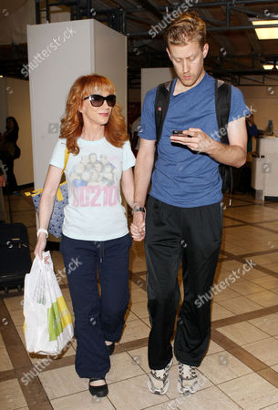 Editorial image of Kathy Griffin and Randy Bick arriving at Los Angeles International Airport, America - 25 Jun 2013