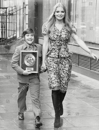 Neil Reid With His Golden Disc Award With Miss World Miss Eva Rueber Staier In Oxford Street.