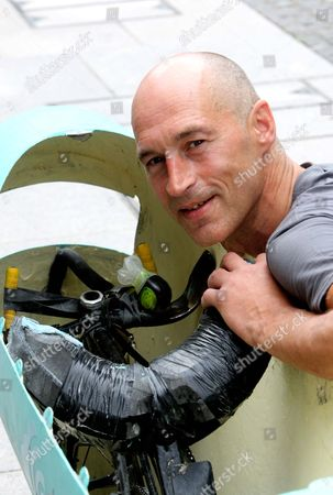 Graeme Obree with his homemade vehicle, called the 'Beastie'