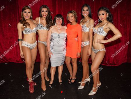 "Stock Picture of Shameless actresses Alice Barry (3rd from left) and Kira Martin (3rd from right) pose with the Ladyboys during the interval . The Ladyboys of Bangkok perform their show , "" Glamorous Amorous """
