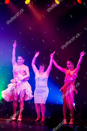 "Stock Photo of Shameless actress Alice Barry (centre) dances to YMCA on stage with the Ladyboys . The Ladyboys of Bangkok perform their show , "" Glamorous Amorous """