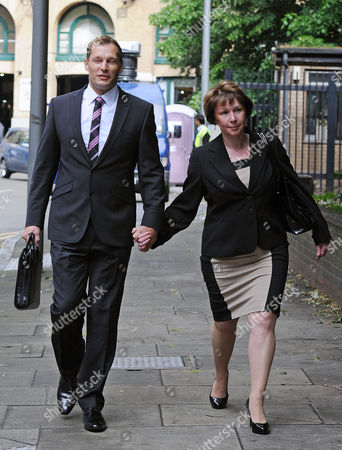 London. Pc Simon Harwood 41 Arrives At Southwark Crown Court With This Wife Helen This Morning. Pc Harwood Is Accused Of Mr Tomlinson's Manslaughter During The G20 Demonstrations In April 2009 .