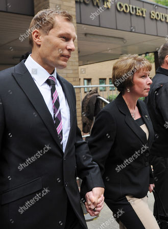 London. Pc Simon Harwood 41 Leaves Southwark Crown Court With This Wife Helen This Afternoon. Pc Harwood Is Accused Of Mr Tomlinson's Manslaughter During The G20 Demonstrations In April 2009 .