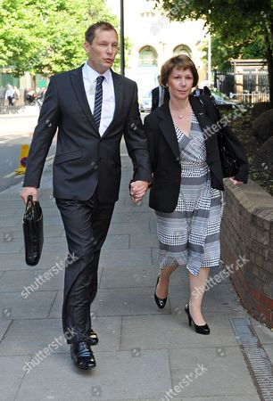 Pc Simon Harwood 41 Arrives At Southwark Crown Court With This Wife Helen This Morning For The Second Day Of His Trial. Pc Harwood Is Accused Of Mr Tomlinson's Manslaughter During The G20 Demonstrations In April 2009 .