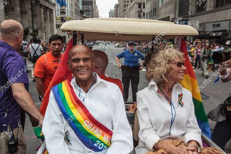 Stock Image of Harry Belafonte and Julie Robinson on Fifth Avenue