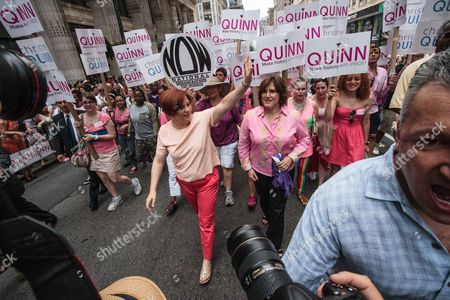 Stock Image of Christine Quinn with partner Kim Catullo wave to supporters as they march to a press conference