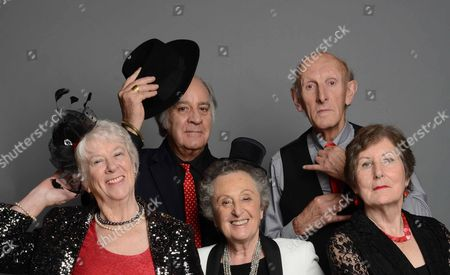 Stock Picture of Left to right - Rosemary Bannister (red top and hat on right side of head), Royston Mayoh (man in spotty red tie holding hat up), Sonia Elliman (centre frame, white jacket on), Seb Craig (bald man straightening his tie), Rosemary MacVie (far right with arms folded),