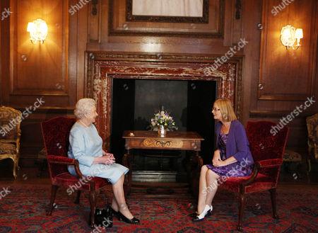 Queen Elizabeth II talks to the Scottish Parliament Presiding Officer Tricia Marwick