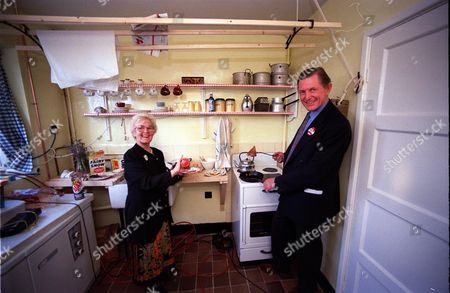 Editorial image of National Trust Director Martin Drury With Sheila Jones In The Kitchen Of Paul Mccartney's Old Home. Sheila Lived In The House For Thirty Years. Beatlemania Came To A Peaceful Liverpool Street Today As The National Trust Unveiled The Childhood Home O