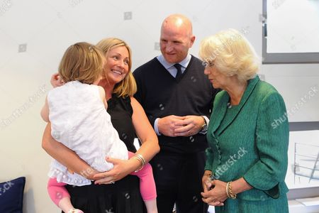 Camilla Duchess of Cornwall meets former footballer and cancer sufferer John Hartson and his wife Sarah and daughter Stephanie