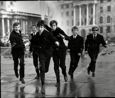 Pop Group 'the Riot Squad' In Trafalgar Square L-r Graham Bonney Bob Evans John Mitchell Ron Ryan Mark Stevens And Mike Martin The Riot Squad Were A Pop Group From London Initially Managed And Produced By Larry Page And Later For Their Reunion By Joe Meek. Members Included Graham Bonney (vocals) Ron Ryan (guitar) Len Tuckey (guitar) Mark Stevens (keyboards) Brian Davies (bass) Mitch Mitchell (drums) Roger Crisp (bass) Terry Clifford (guitar) Butch Davis (piano) Derek 'del' Roll (drums). Their Only Constant Member Was To Be Bob Evans (saxophone) Who After The Band Split For The First Time 'reunited' The Riot Squad With All New Musicians. In Early 1967 They Were Joined By David Bowie Who At The Time Was Recording Material For His Self-titled Debut Album. The Band Consisted Of Six Members: Bowie (vocal Guitar Mouth-harp) Rod Davies (guitar) Brian 'croak' Prebble (vocals) Bob Evans (tenor Saxophone Flute) George Butcher (keyboards) And Derek Roll (drums). This Incarnation Recorded Several Tracks Including A Cover Of The The Velvet Underground's 'i'm Waiting For The Man' And A Velvets-influenced Bowie Original Called 'little Toy Soldier'. These And Other Songs Featuring David Bowie Were Officially Released In 2012 On 'the Last Chapter: Mods & Sods'.