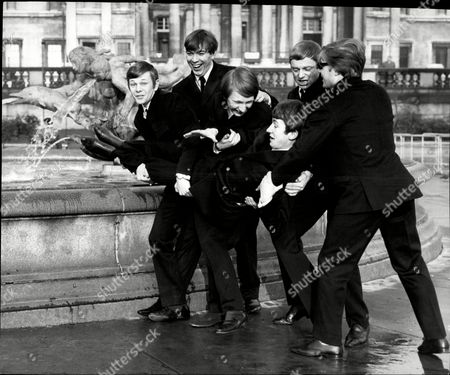 Pop Group 'the Riot Squad' In Trafalgar Square L-r Graham Bonney Ron Ryan Mark Stevens Bob Evans And Mike Martin And John Mitchell The Riot Squad Were A Pop Group From London Initially Managed And Produced By Larry Page And Later For Their Reunion By Joe Meek. Members Included Graham Bonney (vocals) Ron Ryan (guitar) Len Tuckey (guitar) Mark Stevens (keyboards) Brian Davies (bass) Mitch Mitchell (drums) Roger Crisp (bass) Terry Clifford (guitar) Butch Davis (piano) Derek 'del' Roll (drums). Their Only Constant Member Was To Be Bob Evans (saxophone) Who After The Band Split For The First Time 'reunited' The Riot Squad With All New Musicians. In Early 1967 They Were Joined By David Bowie Who At The Time Was Recording Material For His Self-titled Debut Album. The Band Consisted Of Six Members: Bowie (vocal Guitar Mouth-harp) Rod Davies (guitar) Brian 'croak' Prebble (vocals) Bob Evans (tenor Saxophone Flute) George Butcher (keyboards) And Derek Roll (drums). This Incarnation Recorded Several Tracks Including A Cover Of The The Velvet Underground's 'i'm Waiting For The Man' And A Velvets-influenced Bowie Original Called 'little Toy Soldier'. These And Other Songs Featuring David Bowie Were Officially Released In 2012 On 'the Last Chapter: Mods & Sods'.