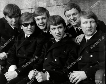 Pop Group 'the Riot Squad' In Trafalgar Square L-r Ron Ryan Mike Martin Graham Bonney John Mitchell Bob Evans And Mark Stevens The Riot Squad Were A Pop Group From London Initially Managed And Produced By Larry Page And Later For Their Reunion By Joe Meek. Members Included Graham Bonney (vocals) Ron Ryan (guitar) Len Tuckey (guitar) Mark Stevens (keyboards) Brian Davies (bass) Mitch Mitchell (drums) Roger Crisp (bass) Terry Clifford (guitar) Butch Davis (piano) Derek 'del' Roll (drums). Their Only Constant Member Was To Be Bob Evans (saxophone) Who After The Band Split For The First Time 'reunited' The Riot Squad With All New Musicians. In Early 1967 They Were Joined By David Bowie Who At The Time Was Recording Material For His Self-titled Debut Album. The Band Consisted Of Six Members: Bowie (vocal Guitar Mouth-harp) Rod Davies (guitar) Brian 'croak' Prebble (vocals) Bob Evans (tenor Saxophone Flute) George Butcher (keyboards) And Derek Roll (drums). This Incarnation Recorded Several Tracks Including A Cover Of The The Velvet Underground's 'i'm Waiting For The Man' And A Velvets-influenced Bowie Original Called 'little Toy Soldier'. These And Other Songs Featuring David Bowie Were Officially Released In 2012 On 'the Last Chapter: Mods & Sods'.