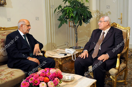 Adly Mansour (R) meets with opposition leader and former U.N. nuclear agency chief Mohamed ElBaradei