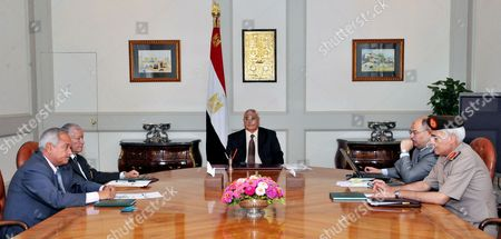 A handout picture released by the Egyptian Presidency shows Egypt's interim president Adly Mansour (C) meeting with opposition National Salvation Front leader Mohamed ElBaradei (5thL) and heads of opposition Tamarod (Rebellion) group and other opposition leaders