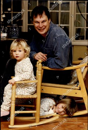 Stock Image of Author Michael Ridpath With Daughters Laura Ridpath (left) And Julia Ridpath (right) Michael Ridpath Is An English Author Of Thrillers Based Around The World Of High Finance. He Was Born In Devon In 1961 And Grew Up In Yorkshire. He Was Educated At Millfield School And Merton College Oxford Where He Obtained First-class Honours In Modern History And Represented The University At Athletics. He Spent Eight Years Working As A Bond Trader At An International Bank In The City Of London. His Past Employers Include Saudi International Bank And Apax Partners. Michael Ridpath Lives In North London With Three Children And His Wife Barbara Former Managing Director Europe Of Standard And Poor's And Currently Chief Executive Of The International Centre For Financial Regulation. His Latest Work Is The Fire & Ice Series About An Icelandic Detective Called Magnus Jonson.