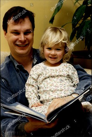 Editorial photo of Author Michael Ridpath With Daughter Laura Ridpath Michael Ridpath Is An English Author Of Thrillers Based Around The World Of High Finance. He Was Born In Devon In 1961 And Grew Up In Yorkshire. He Was Educated At Millfield School And Merton College