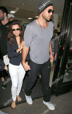 Editorial image of Eva Longoria and boyfriend Ernesto Arguello arriving at Los Angeles International Airport, America - 09 Jul 2013
